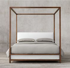 RH's Montrose Low Panel Four-Poster Bed:Inspired by the streamlined glamour of the late 20th century, our four-poster bed pairs a sleek, brass-finish metal frame with a padded headboard for a clean, angular silhouette.