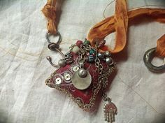 Gypsy amulet necklace with shabby embroidered vintage textiles, kuchi and beads, silk and Buddha hand