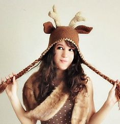 This whimsical crocheted deer hat pattern includes instructions for an adult sized deer hat complete with deer ears, antlers, earflaps and braids!