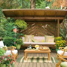 Plants and an overhead structure make this deck feel like an intimate outdoor room.