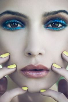 blue eyeshadow, yellow nails