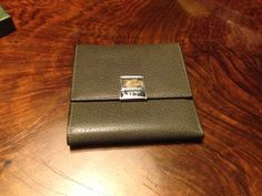 Leather purse with a silver and gold closure