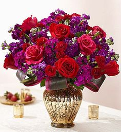 This is a wonderful, vivid assortment of all the favorites. Stock, roses and other bright blooms gathered in this beautiful vase. It won't disappoint!