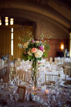 A beautiful tall centerpiece with branches and all! {Chelsea Brown Photography}