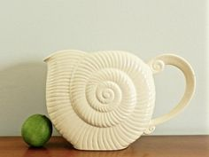 Hey, I found this really awesome Etsy listing at https://www.etsy.com/listing/250393567/vintage-spiral-snail-shell-pitcher-jug
