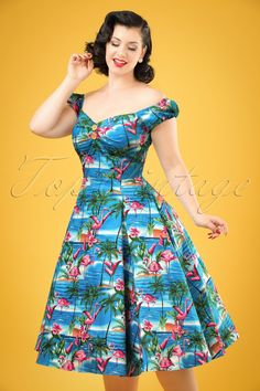 This 50s Dolores Flamingo Island Doll Dressis a real summer favourite, it's not hard to see why!Top in carmen style, cute puffy sleeves which can be worn off-shoulder, a full swing skirt and pleats at the bust for a beautiful cleavage, wow!And then we didn't even mention the fantastic print of flamingos resplendent on a background of perfect blue seas and sandy beaches with palm trees... she'll brighten up any day.Made from a firm yet supple...