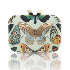 The Papillon Morley in green and metallic gold butterfly prints is designed to give the feeling of the most magical midnight garden. The Damien Hirst inspired clutch features a brass box case covered with green satin, KOTUR's signature double rock magnetic closure, brocade lining and a 30 cm drop-in chain. The compact shape fits your essentials, including your iPhone 6.