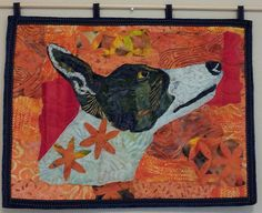 This beautiful greyhound art quilt features the pose of a greyhound intent on something specific - probably a treat. The inspiration for this wall