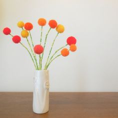 Orange pom pom flower arrangement.  White Vase. Wool felt flowers. Spring bouquet.  Dandelions, craspedia.  Bright yellow flowers.  Pompom