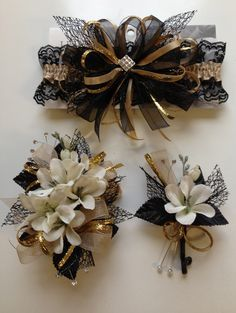 Gold and black prom corsage and matching prom garter. Letsdancegarters.com