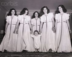 The Dionne Quintuplets with Their Little Brother