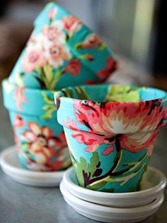 Cover Clay Pots With Fabric, Or Decorative Paper, and Outdoor Mod Podge To Seal http://christinechitnis.com/2010/01/28/pretty-pots/