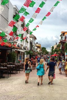 Main shopping drag, 5th Avenue in Playa del Carmen, Mexico. Along with the most ridiculous souvenirs you've ever seen, you'll find bits of authentic Mexico like artisan crafts, textiles.
