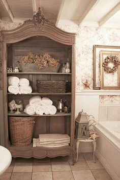 Great idea for a repurposed armoire.  Of course a very large bathroom is required, but great idea.  Would also work in a kitchen for dishes or glassware.