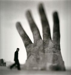 Keith Carter, Hand and Man, black and white photo.
