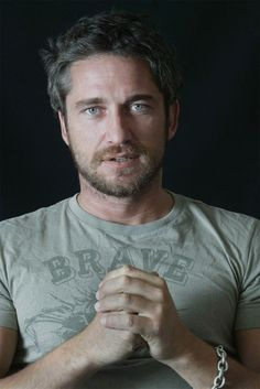 Gerard Butler...  ::sigh:: I WANT ONE!!!