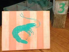 Distressed coral and white with turquoise shrimp wood painting decor on Etsy, $26.00
