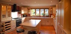 Like the red tiles, white cupboards and wood counters with the terracotta floor.