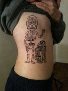 Day of the Dead R2-D2 and C3PO.   I love Star wars so much and R2 and C3 are beyond my favorite characters.    Done by Greg Howell at Jack Brown's Tattoos in Fredericksburg, VA