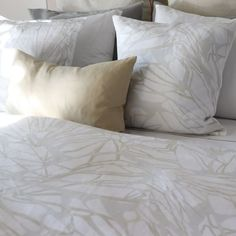 White linen duvet cover with organic print in gold and silver tones from Huddleson