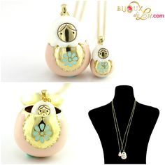 Pink Enameled Matryoshka Necklace Set: Each set consists of a mother locket on a long gold plated chain & a baby doll pendant on a long gold plated chain. The mother locket is around 1 3/8 inches high while the baby is 5/8 inch high. The pendants are made of gold plated brass and then hand painted in pink enamel. http://bijouxdelou.com/index.php/products/by-theme/signature-pieces/product/pink-enameled-matryoshka-necklace-set