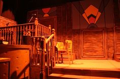 Stage set for Bugsy Malone. Note the art deco design & wood panelling