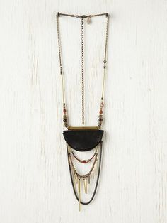 Eclipse Necklace.  Interesting concept to explore with various materials for the eclipse.