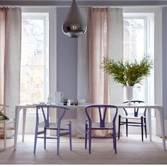 Decorating With Soft but Sophisticated Pastels: Muted shades of lavender and peach feel incredibly modern when coupled with a silver teardrop pendant and ombre dining chairs.    Source
