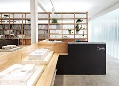 TAOA Studio by Tao Lei Architecture Studio - example of shelves and work tables.