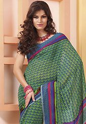 Exquisite combination of color, fabric can be seen here. This green and blue faux georgette saree is nicely designed with paisley, abstract, geometric and stripe print work. Saree gives you a singular and dissimilar look. Matching blouse is available. Slight color variations are possible due to differing screen and photograph resolution.