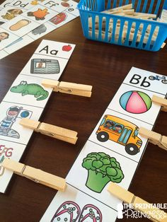 Beginning Sound center for Kindergarten. Tip: Before laminating, put a small sticker on the back of the correct pictures to make this activity self checking! Clothespins make this a great fine motor activity.
