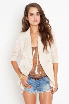 long silk blazer in creme. Dresses up any outfit! Or pair this with a few casual pieces for an eclectic look