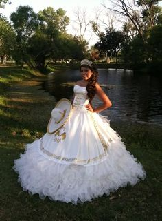 Quinceanera gowns - Quinceanera is a tradition which originally arrived from the Latin America, and it represents the Girl's transformation from a kid to an adolescent. Dama Dresses, Quince Dresses, Prom Dresses, Wedding Dresses, Mexican Quinceanera Dresses, Mexican Dresses, Quinceanera Ideas, Vestido Charro, Quinceanera Collection