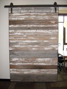 Sliding barn door with reclaimed wood. Like how they ran all the wood planks horizontal.