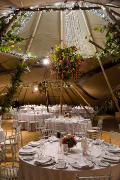 A huge tipi set up for a stylish 70th birthday bash - images courtesy of http://www.jamesdarlingphotography.com Tipis by www.worldinspiredtents.co.uk, flowers by http://www.taylorcorps.com
