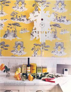"""Toile de Jouy, sometimes abbreviated to simply """"toile"""", is a type of decorating pattern consisting of a usually white or off-white background on which a repeated pattern depicting a fairly complex scene, generally of a pastoral theme such as (for example) a couple having a picnic by a lake.  This African American designer used a toile depicting African Americans in a French aristocratic life.  The ground color is contemporary in a bright yellow with the figures in black and white.  So well done."""