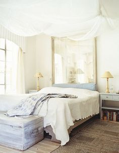 some mixed reactions to the idea of using a mirror as a headboard, but in an elegant setting such as this dreamlike bedroom, it reads as sweet and light rather than cheesy.
