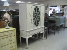DISTRESSED WHITE CHINA CABINET $169