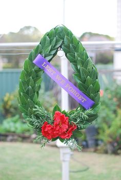 ANZAC tribute wreath for ANZAC Day Each element of the wreath is symbolic and every effort is made so that these details are presented correctly. Anzac Day, Laurel Wreath, Flower Boys, Real Flowers, Effort, Crafting, Presents, Symbols, Wreaths