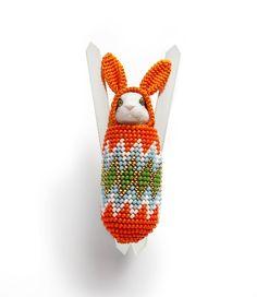 Cradleboard Bunny brooch by Felieke van der Leest. Argentium silver, glass beads, textile, plastic animal, gold.