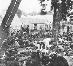 """BASIC (Grade This image of a field hospital during the Civil War will help readers visualize Whitman's imagery in """"A March in the Ranks Hard-Prest, and the Road Unknown. Us History, American History, History Photos, Monuments, History Magazine, War Photography, America Civil War, Civil War Photos, Gettysburg"""