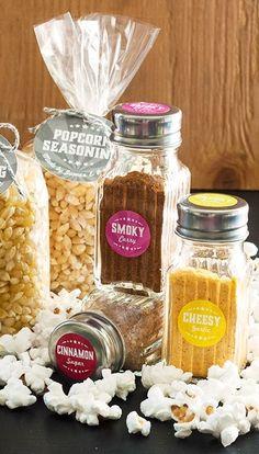 Six homemade popcorn seasonings: cheesy garlic, Italian herb, smoky curry, Mexican chocolate, spicy citrus and cinnamon sugar.