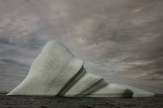 Simon Harsent, 'Melt: Portrait of an Iceberg'. Hauntingly beautiful photographs, documenting the journey of a string of icebergs.  Arriving as sad and battered fragments of the once grandiose and alien glaciers, these icebergs remind us of the fragility of the arctic and the imposing threat of climate change.