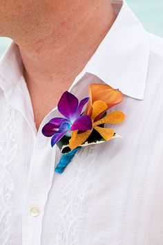 Tropical Boutonniere. Bright Wedding Flowers. Planning by http://www.shannalumpkinevents.com/index2.php#/home/ Photo by http://www.adamplusalli.com/
