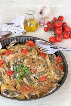 Tiella di alici secondo di pesce con alici patate e pomodorini