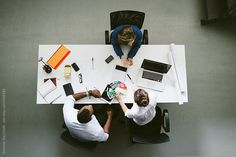 Young business people working - overhead by Wave | Stocksy United
