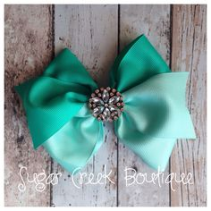 Www.facebook.com/sugarcreboutique   Two toned 5 inch pinwheel with your choice of clip.   Classy & sassy from Sugar Creek Boutique <3