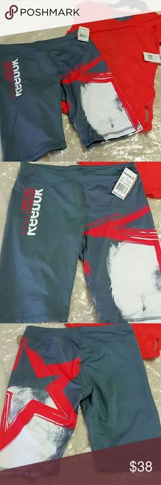 Reebok athletic set NWT Brand new with tags Reebok matching athletic set.  Shirt size Large and bike shorts are XL.  Color is gray with red orange. Reebok Matching Sets