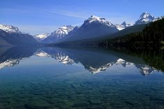 Reflection on Lake McDonald by glaciernps, via Flickr