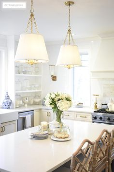 Tailored pendant lighting with shades and brass detailing is an elegant and chic addition in the kitchen. Dining Room Light Fixtures, Hanging Light Fixtures, Kitchen Fixtures, Dining Room Lighting, Dining Rooms, Diy Kitchen Projects, Diy Kitchen Decor, Home Decor, Diy Projects
